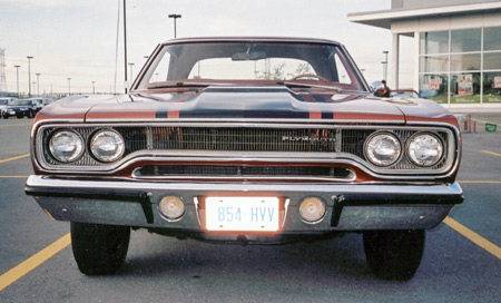 1970 model had looped barbell style grille with vertical fins.