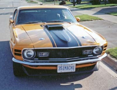 The 1970 Mach 1 has single headlamps, different grille and no side stripes.