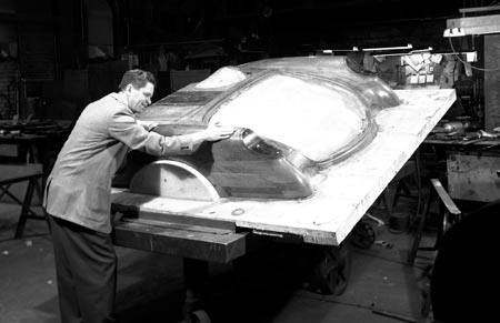 The body panel molds started with smoothly-finished positive wooden patterns, called 'bucks', like this one. The fiberglass and resin was laid over this pattern to produce a negative fiberglass pattern. Repeating the process with the negative pattern resulted in positive fiberglass panels from which the body was assembled.