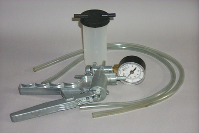 "The Mityvac is a trigger-operated vacuum pump that lets one person successfully bleed brakes at the wheel, without depressing the pedal or wasting fluid. This versatile little pump moves about 1 cu. in. of fluid with each stroke, pulling out dirt, old fluid, and air. It develops and holds approximately 25 inches of vacuum. The kit includes the pump, brake bleeding adapter package user's manual, 3 lengths of 1/4"" I.D. tubing (1 1/2"", 3"", and 18""), 3"" of 5/32"" tubing and a reservoir jar with transfer and storage lids."