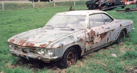 1966 Corvair Monza found rotting in field.