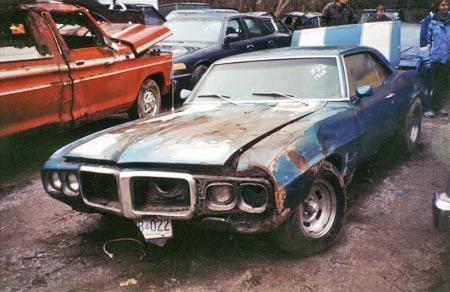 1969 Firebird hardtop damaged in fire and left to rot in yard.