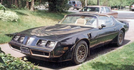 A 1980 SE turbo trans am sits for years on a driveway.