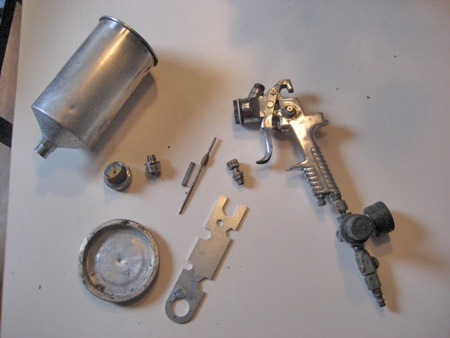 These are the pieces of the gun after dismantling it, including the tool that came with the gun to dismantle it with.