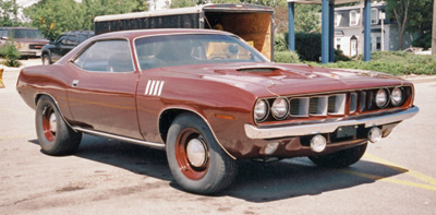 E bodies can be gaudy or plain like this 71 'cuda Six Pack with Burnt Orange paint and column shift automatic.