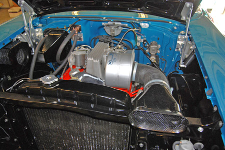 Special thin radiator paint helped this '57 Chevy 'fuelie's' engine bay to shine.