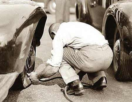 Filling your tires to the correct air pressure was just as important to good fuel mileage in 1942, when this photo was taken, as it is today.