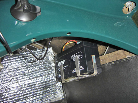 A 12-volt dry cell battery designed for electric fences is mounted behind the dashboard in this '25 Willys-Knight and powers a Garmin 260 GPS.