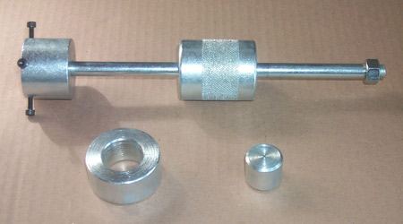 Zip Products also has a special tool available for removing and installing u-joints, shown here. It consists of a sliding cylindrical hammer (top), a receiver cup (lower left) and a button (lower right). The button goes into the lower bout of the sliding hammer and is retained by tightening the four Allen screws for removing u-joints.
