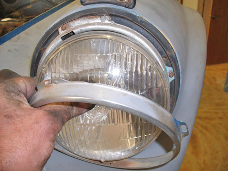 Removing the chrome rim is the first step in headlight removal.