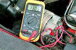 Connect the positive and common leads of a multimeter to the corresponding terminals on the alternator, select the 20-volt range and see what kind of voltage the new alternator is putting out; it should be between 12.3 and 14 volts if it's working correctly. When it checks out OK, shut the engine off, disconnect the multimeter and slip the rubber boot over the positive terminal on the alternator. Job Completed!