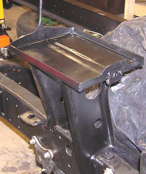 The finished battery tray positioned on frame.