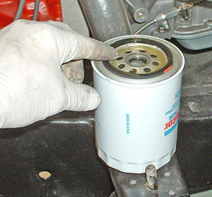 An important step is spreading oil over the rubber gasket.