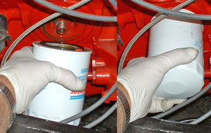 Carefully start the filter on its post and tighten hand tight.