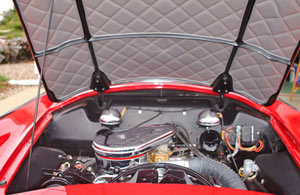 The underside of the Plymouth Belmonts hood is covered with quilted material that acts as a sound deadener. Twin chrome-capped horns are mounted on the firewall and the juice is provided by a 6-volt battery.