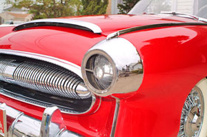 The headlights are recessed into chrome buckets with cross-hair grills keeping with the jet age styling trends of the period.