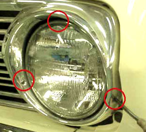 Three screws (circled in red...the top screw is not visible in this photo) hold the headlight bezel in place. Be careful that you don't scratch the bezel when you remove it.