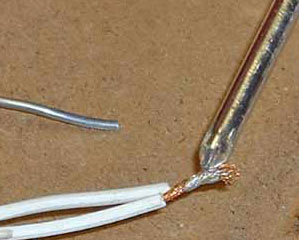 After the solder flows over the wires, remove the heat.