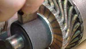 To maintain correct curvature, we wrapped sandpaper around the commutator when dressing up the brushes.
