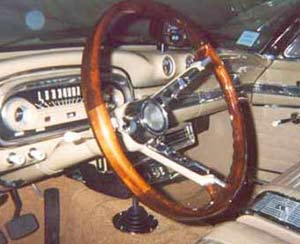 The Falcon's steering wheel, showing nifty little polished metal fittings at the junction between the wood and plastic.