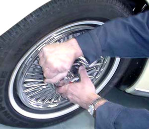 The best way to put the hubcap back on is with your hand. It's too easy to dent them using anything else.