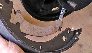 This photo shows how the brake cable attaches to the emergency brake pivot.