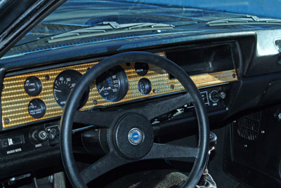 All Cosworth Vegas featured a gold-toned engine-turned dash with full instrumentation. The horn button of the steering wheel also identifies it as a Cosworth edition. The Vega steering wheel was also used on the 1976 Corvette — a distinction owners of '76 'Vettes tend to play down, understandably.