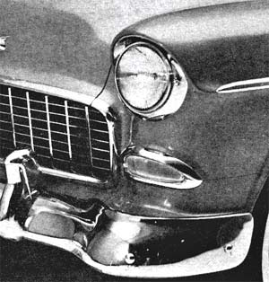 Frontal treatment of the 1955 Chevrolet features inward slope, Ferrari-type grille, hooded headlights and wrap-around bumper.