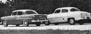 1955 models have ball-joing front suspension with anti-dive features. Note how the '55 stays level, '54 dives braking.