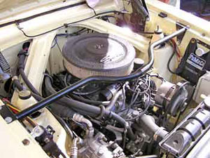 The 289 cubic inch engine sports a modern Edelbrock 4-barrel carburetor and looks identical to the original 260.