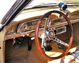 The original plastic wood look steering wheel has been replaced with a real wood one.