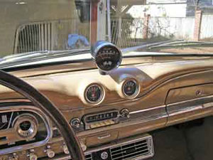 The mid-dash instrument pods are similar to those found in Shelby Mustangs.