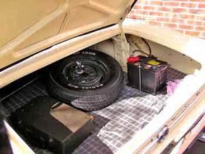 Moving the battery to the trunk improves weight distribution.