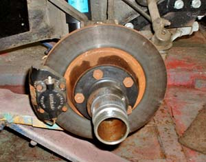 The Jag's front rotors measured nearly 0.10 runout from true.