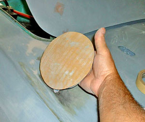 Circular foam pads are available that accept adhesive-backed paper. These are great for sanding contoured surfaces, whether the material is wood or metal.