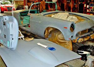The grey URO finish is being sanded and filled, as required. Note the red filler spots on the already-sanded fender.