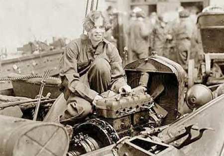 Grace Wagner works on an engine during an auto mechanics class at Central High School, in Washington, DC, in 1927.