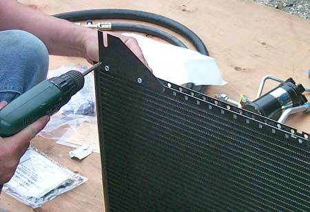 Lower and upper condenser brackets are attached to the condenser using the supplied bolts.