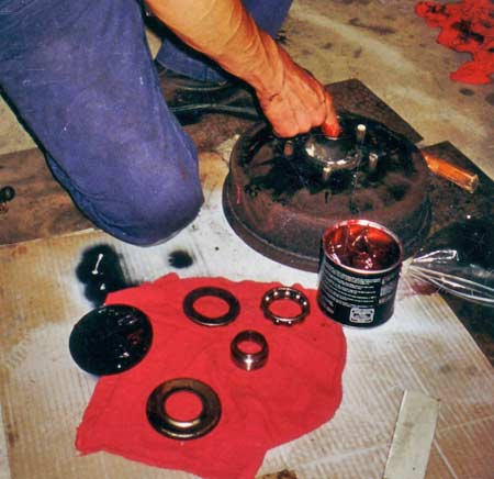 Packing the cleaned up or new ball bearing race with grease can be done by hand using special wheel bearing grease sold at any auto supply outlet.