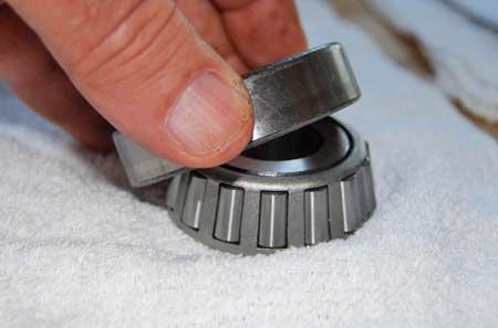 On newer model cars, you may find pin-shaped roller bearing that taper on one end like these.