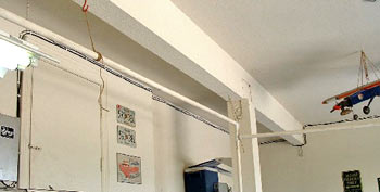 Hooks in ceiling to stabilize frame